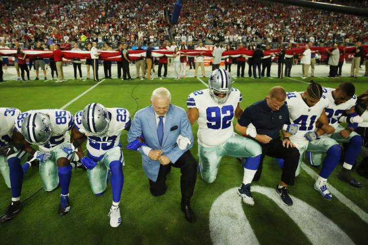 Cowboys kneeling