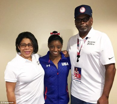 Biles with parents