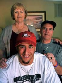Colin Kaepernick with parents